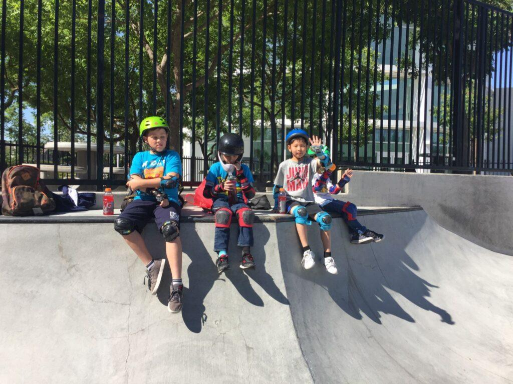 A group of kids with skate gear at Rob Skate Academy